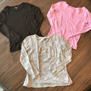Three Old Navy girls size 8 long sleeve tops